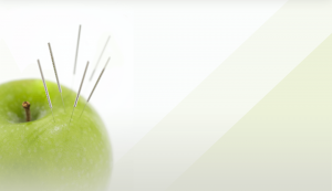 apple with acupuncture needles